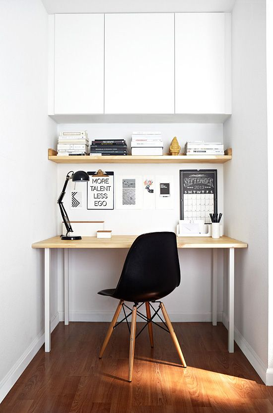 03-a-mini-home-office-nook-in-white-with-a-closed-storage-space-and-a-sleek-desk-plus-a-black-lamp-and-chair