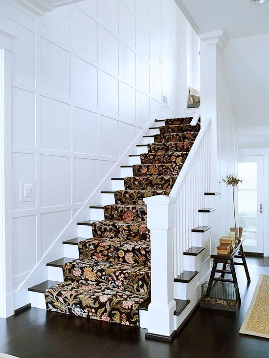 floral stair runner with white panelled wall on staircase