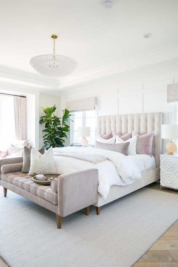 Elegant neutral luxurious master bedroom with blush accents