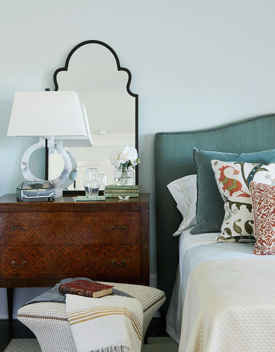 moroccan mirror style with bedside dresser and patterned cushions bedroom
