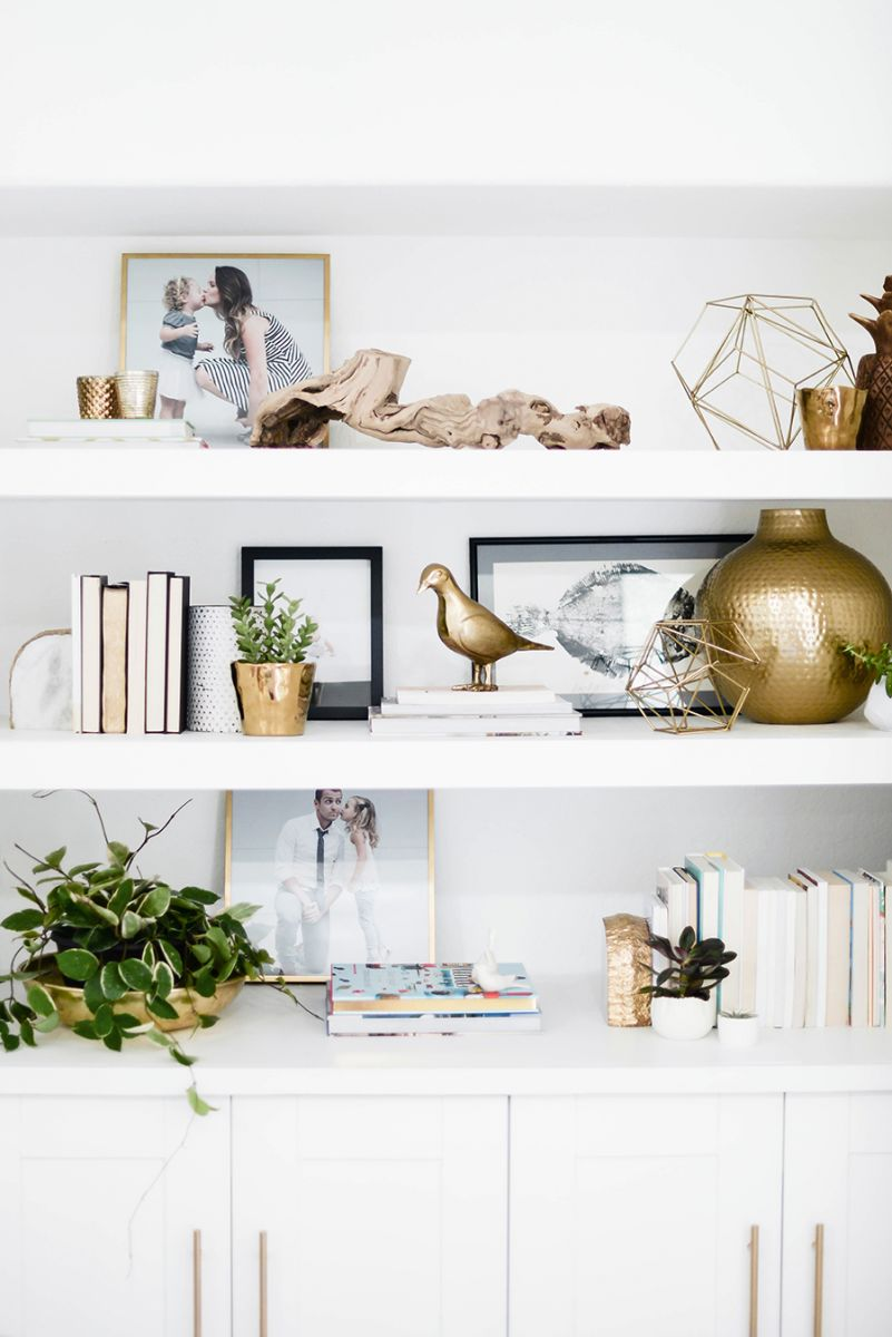 White-shelving-styled-with-gold-sculpture-and-books