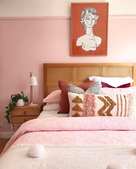 rattan headboard bedroom in blush and crimson red