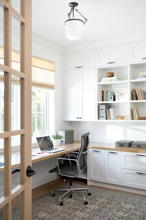honey-stained-wood-floating-desk-below-windows
