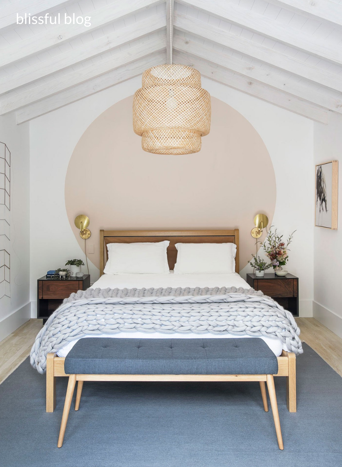 Bedroom with circular paint blocking feature and ikea rattan shade