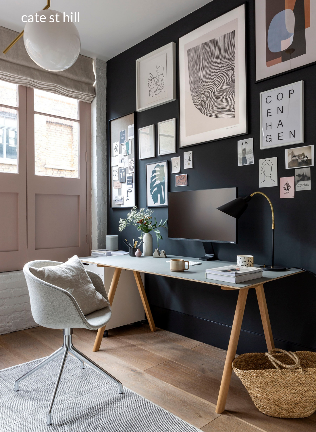 dark feature wall home office design with gallery wall