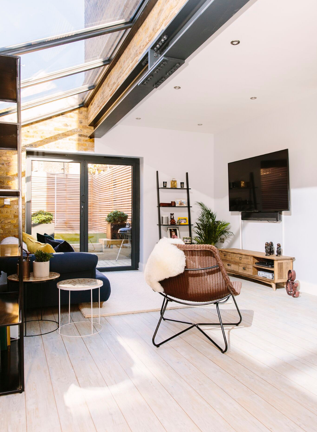 living room interior design with bifold doors and skylights